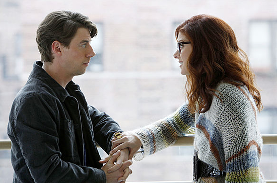 Debra Messing's character, Julia, wears a cool knit sweater.
