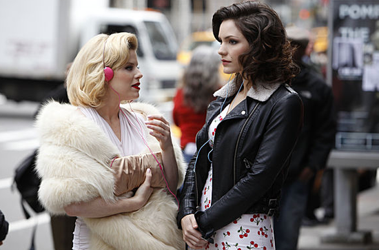 Katharine McPhee's character, Karen, juxtaposes a sassy cherry-print dress with a rough leather jacket.