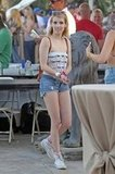 Emma Roberts wore cutoff shorts with sneakers to the second weekend of Coachella.