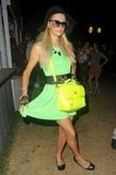 Paris Hilton showed off her neon dress and bag at Coachella's second weekend.