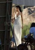 Rihanna donned a long white gown for a shoot for Harper's Bazaar in Malibu.