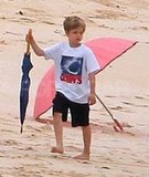 Shiloh Jolie-Pitt used an umbrella as a walking stick as she explored around.