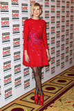 Agyness Deyn added a touch of quirkiness to her sweet Henry Holland with a pair of chunky red platforms.