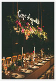 Hanging script above a lush flower box makes for an elegant, unique touch at the head table. Source: Tec Petaja via 100 Layer Cake