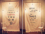 Creative, wordy backdrops make a personalized statement hanging at the reception. Consider a favorite poem, quote, or phrase that means something to you as a couple. Source: Clayton Austin via Green Wedding Shoes
