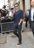 Zac Efron greeted his fans while leaving BBC Radio in London.