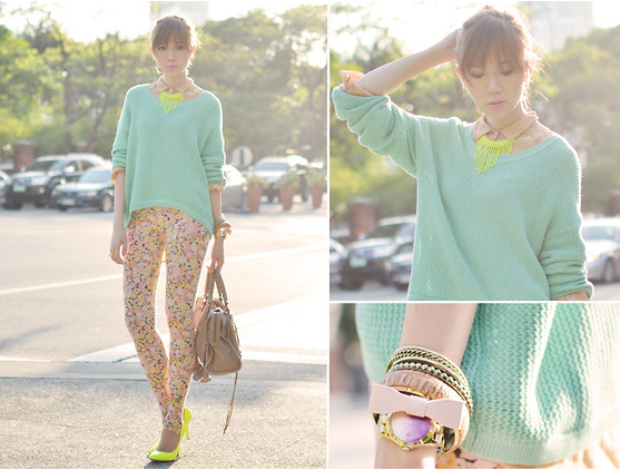 A citrus-hued pop on a necklace and heels goes a long way in brightening up printed jeans and a pastel sweater.  Photo courtesy of Lookbook.nu