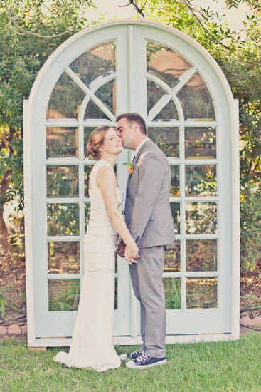 A pair of standing doors perfectly sets the ceremony scene, and the type of doors can make a major statement. Arched glass doors say something very different from antique wooden doors, for instance, so get creative with your options. Source