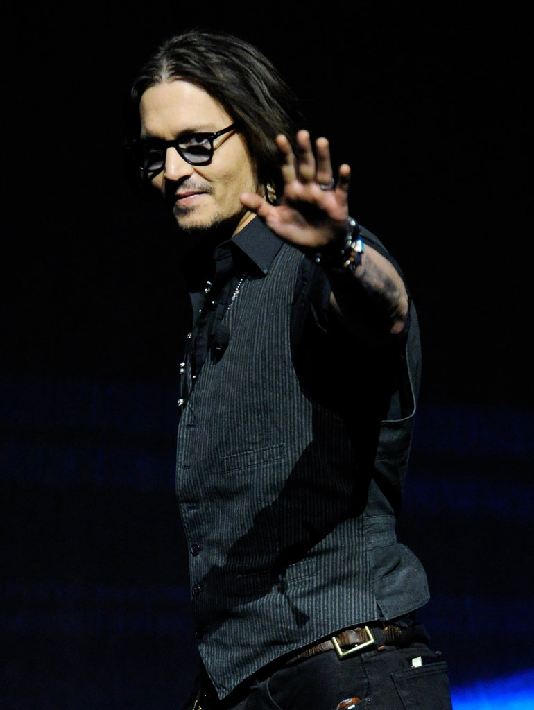 Johnny Depp waved to the camera at CinemaCon.