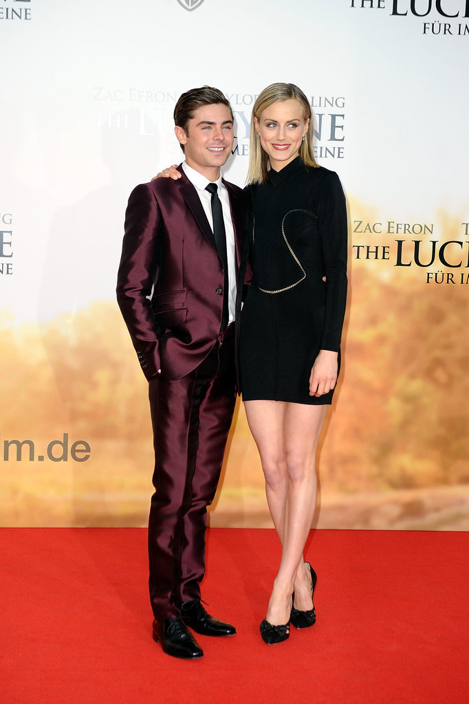 Zac Efron and Taylor Schilling posed together at the premiere of The Lucky One.