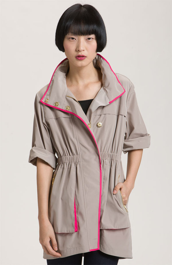 We love the hardware and hot pink piping on this lightweight anorak.  Ali Ro Short Sleeve Anorak With Contrast Trim ($308)