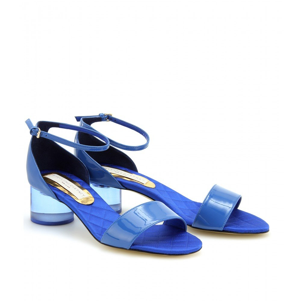 Stella McCartney never gets it wrong; we'd style these sandals with a sweet white lace dress.  Stella McCartney Patent Perspex Sandals ($805)
