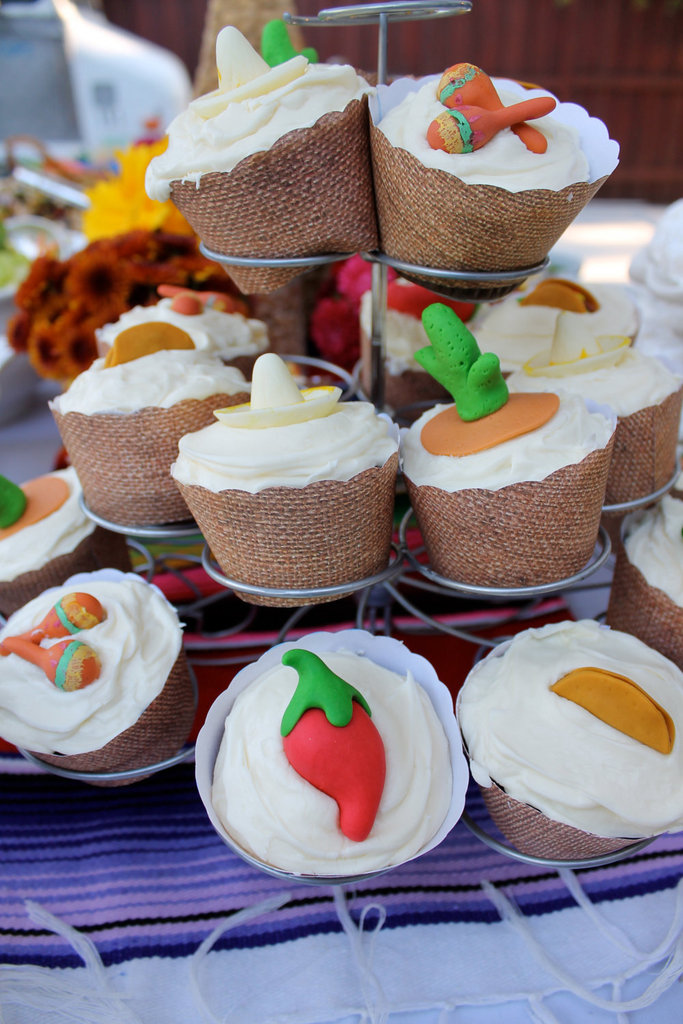Dress up your standard sweets with these Edible Fiesta Cupcake Toppers ($26 for 16). Made of vanilla fondant, the toppers are both tasty and cute. Guests will love the variety of sombreros, chili peppers, cacti, tacos, and maracas.