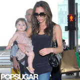 Victoria Beckham carried daughter Harper Beckham.