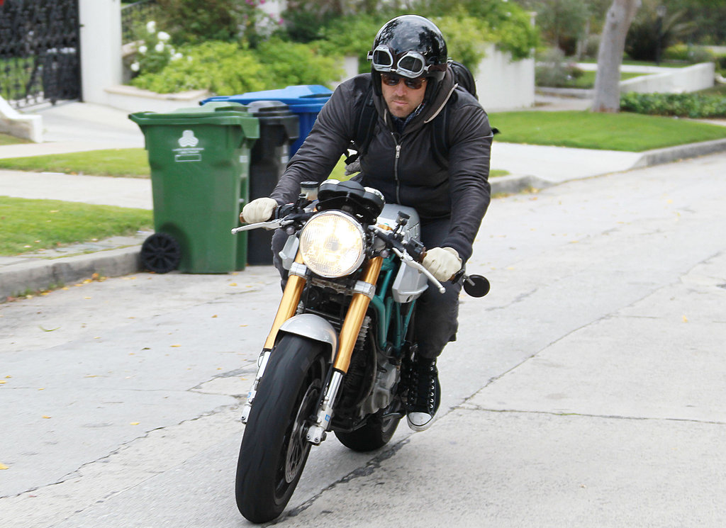 Ryan Reynolds wore a helmet while riding his motorcycle.
