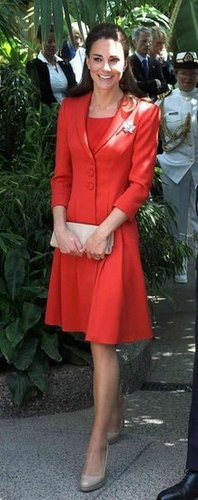 Here's a full-length view of her red-on-red ensemble. She chose a Catherine Walker dress to go with her red blazer and nude LK Bennett pumps.