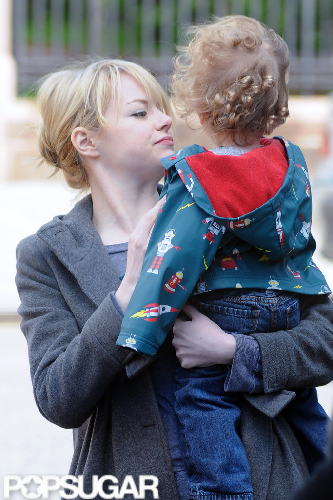 Emma Stone spent time with a friend's son while on the way to breakfast in NYC.