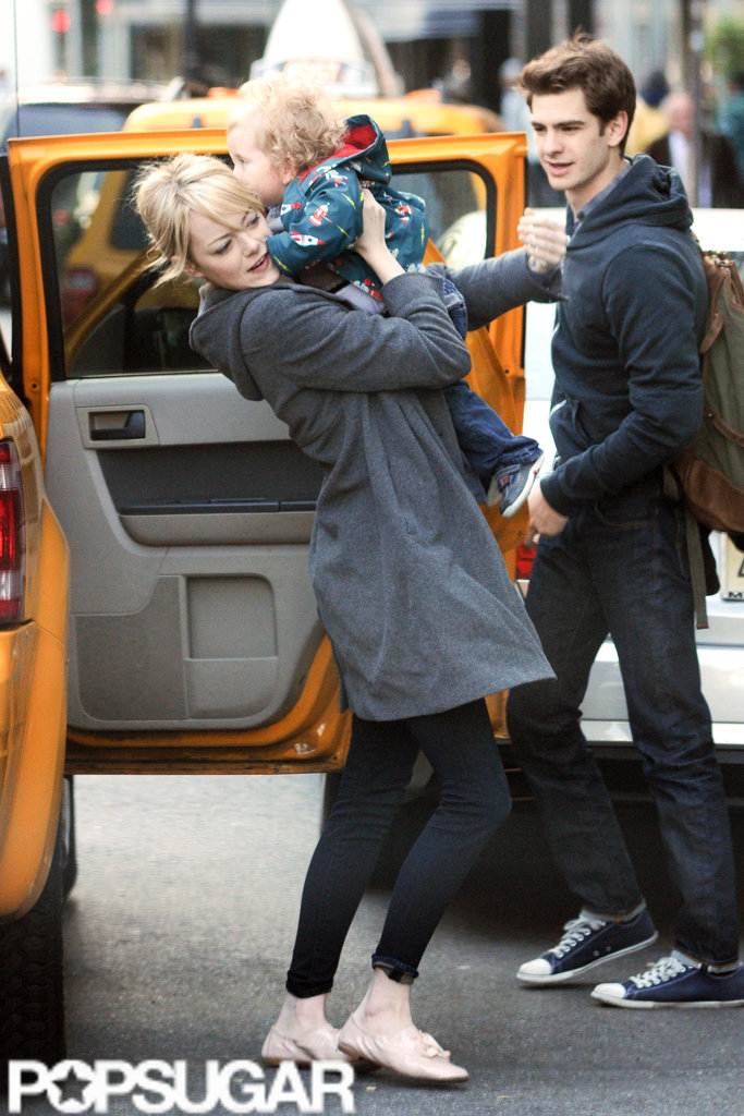 Emma Stone and Andrew Garfield carried a friend's son out of a taxi on the way to breakfast in NYC.