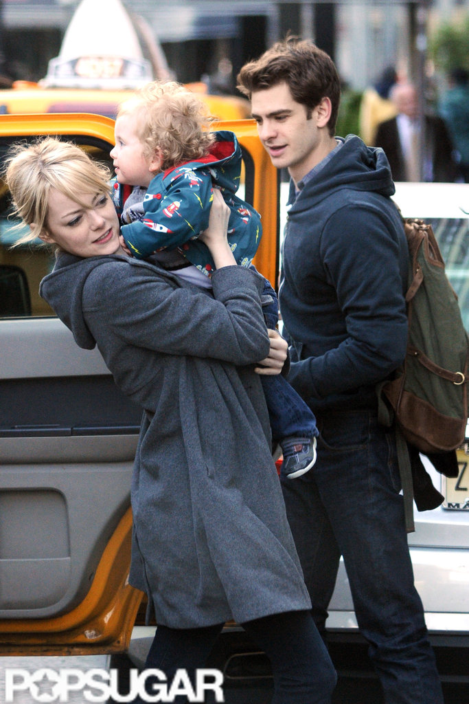Emma Stone held onto a friend's son in NYC.