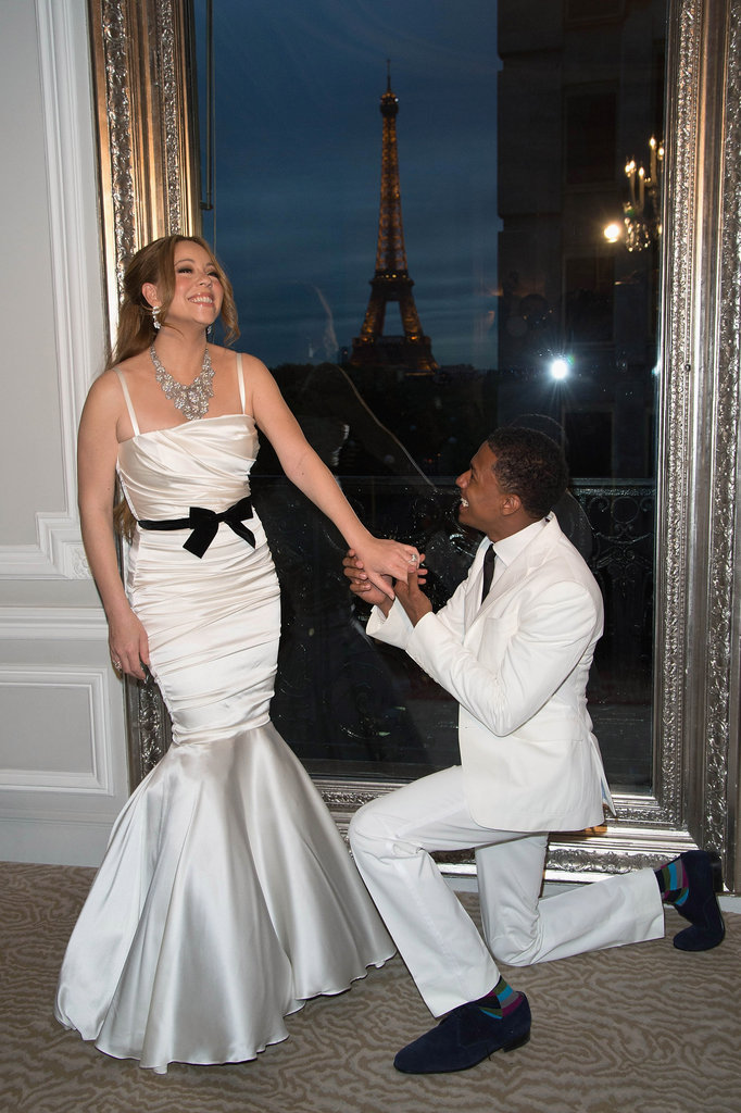 Nick Cannon got down on one knee for a photo.
