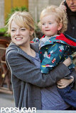 Emma Stone and her little friend smiled while out in NYC.