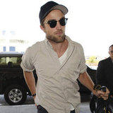 Robert Pattinson arrived at LAX solo.