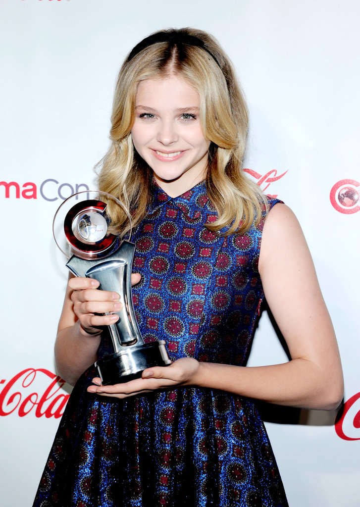 Chloe Moretz wore a purple Kenzo dress to accept the female star of tomorrow award at the CinemaCon awards ceremony in Las Vegas.