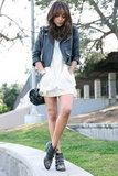 Revenge star and street styler Ashley Madekwe knows how to punch up an LWD — embellished black booties and a moto-inspired leather jacket will toughen the vibe, but keep it sleek. Photo courtesy of Lookbook.nu