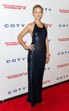 Carolyn Murphy stunned in a liquid, midnight-blue halter gown.