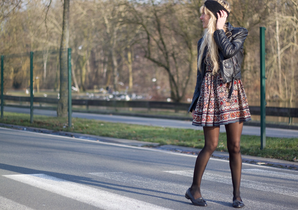 Still feeling the Spring chill? Add tights and a leather jacket to your floral-print dress getup. And we're totally loving the tasseled loafers here, too. Photo courtesy of Lookbook.nu