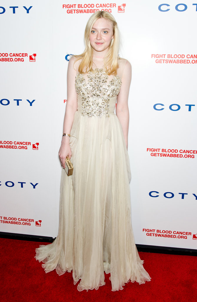 Dakota Fanning opted for a glamorous Elie Saab gown in a creamy hue.