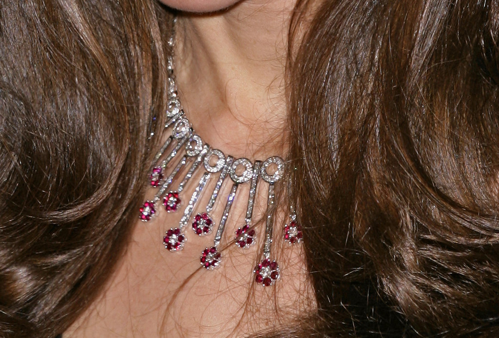 Check out her pretty pink and white diamond-encrusted collar necklace at the Sun Military Awards.