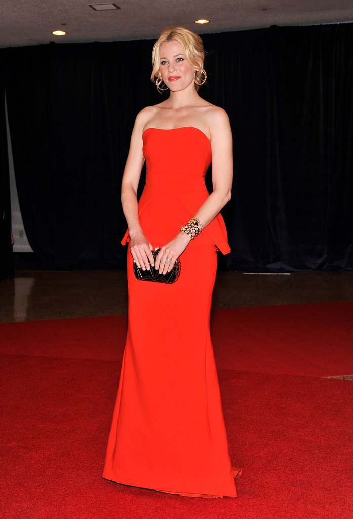 Elizabeth looked glamorous in a floor length red gown.