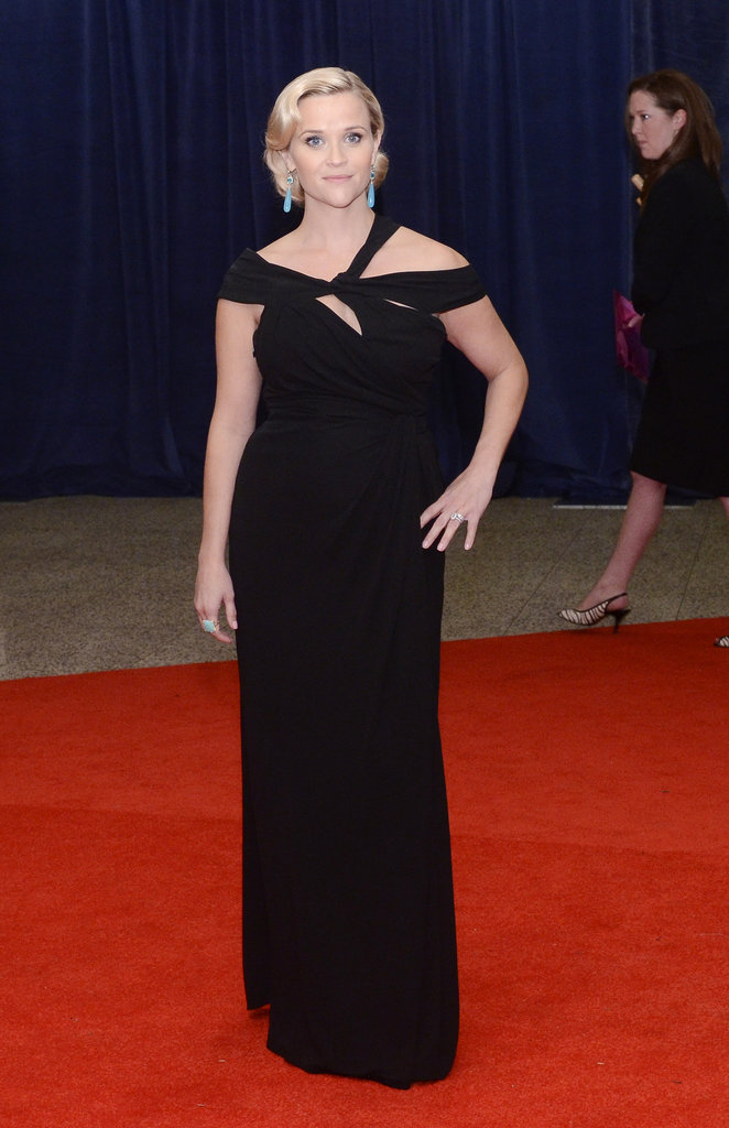 Reese Witherspoon posed in her black gown on the red carpet.