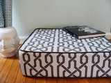 This Floor Cushion ($92) is handcrafted with high quality, durable gray and white designer geometric fabric.