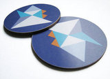 Add geometrics to your tabletop with this Pill Coaster Set ($20).