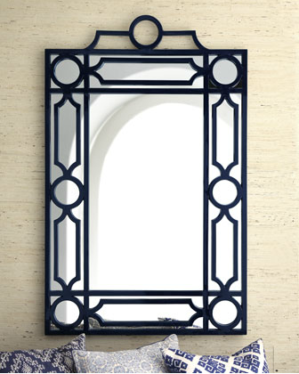 The elegant frame of this Navy Geometric Mirror ($525) makes it welcome in most any room.