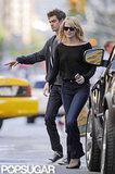 Emma Stone and Andrew Garfield hailed a taxi after grocery shopping in NYC.