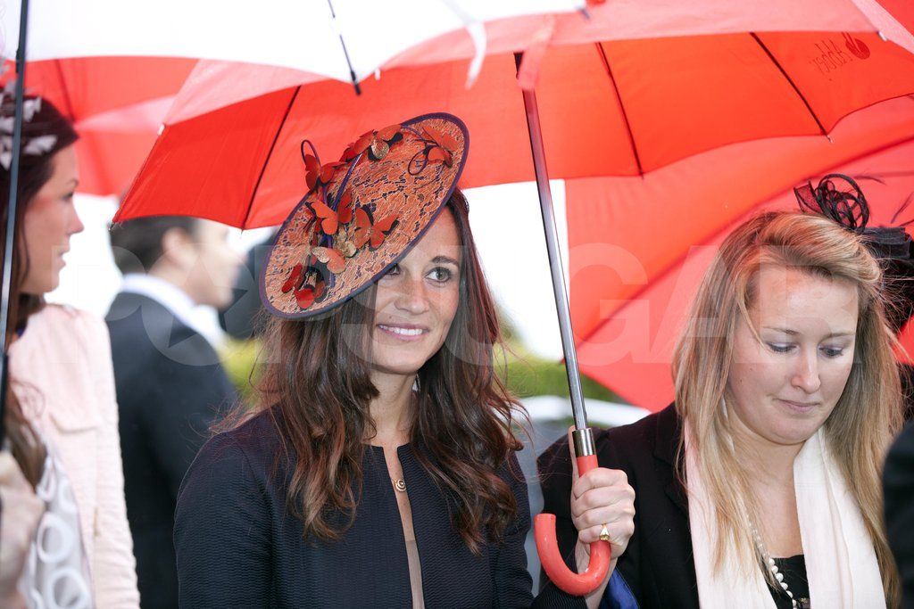 Pippa Middleton arrived at Hannah Gillingham and Robert Carter's wedding in England with a friend.