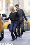Emma Stone opened the taxi door for Andrew Garfield while he carried groceries from Whole Foods in NYC.