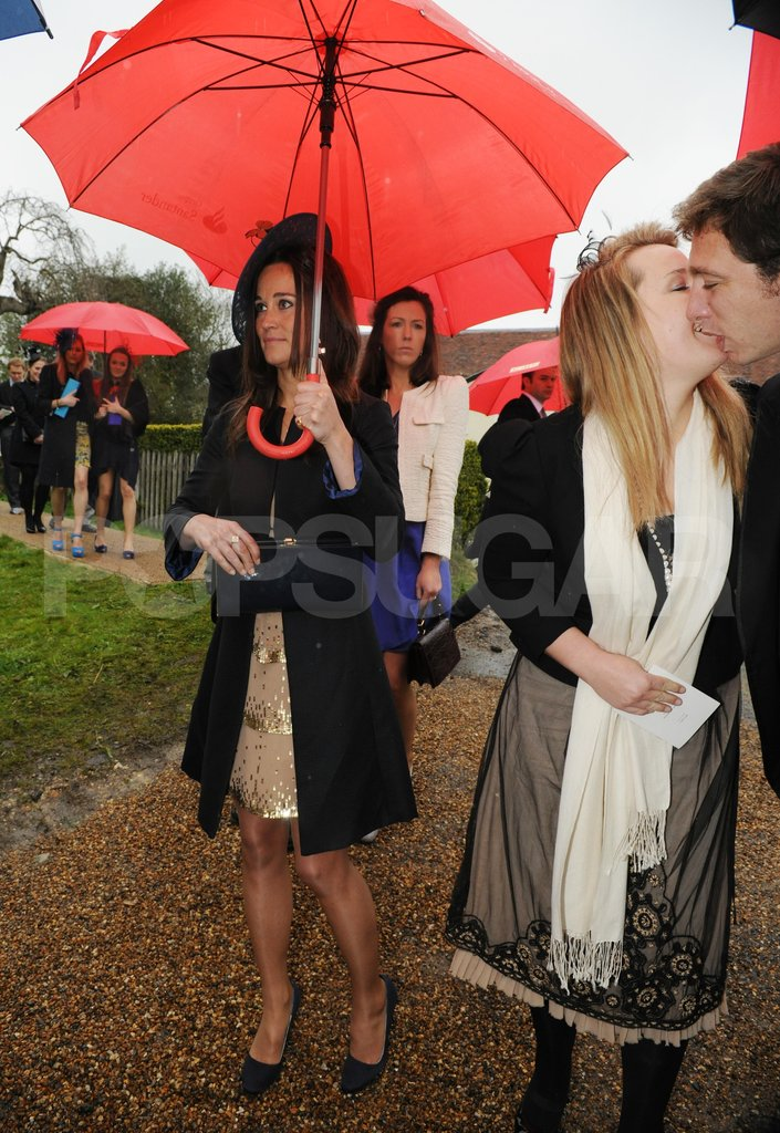 Pippa Middleton with an umbrella.
