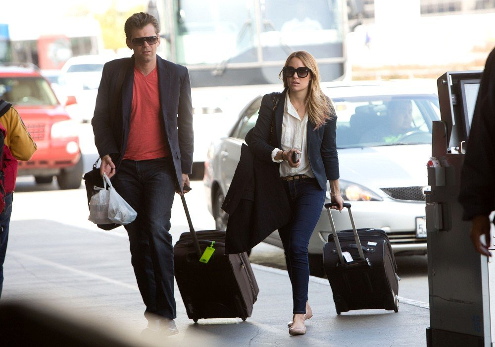 Lauren Conrad arrived at LAX with a friend.