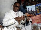Diddy smoked a cigar during the 2001 races.