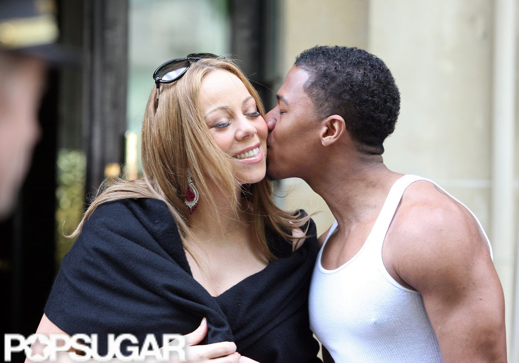 Nick Cannon showed some love for his wife of four years as they left their Paris hotel.