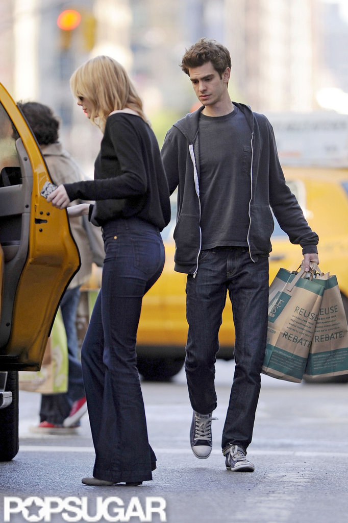 Emma Stone got into a taxi door while Andrew Garfield followed behind carrying groceries from Whole Foods in NYC.