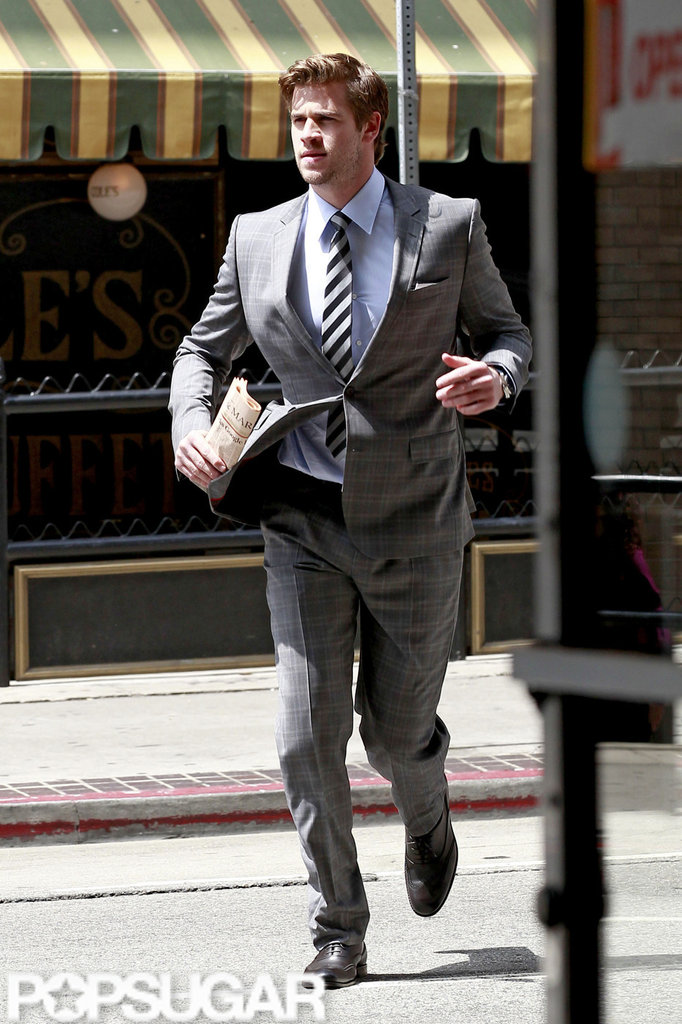 Liam Hemsworth jogged in a gray suit for a Men's Health photo shoot in LA.