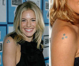 Sienna Miller has had a set of three stars in a triangle shape on her upper right arm for at least six years.