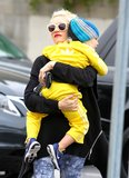 Gwen Stefani carried an adorable Zuma Rossdale wearing a yellow sweatsuit.