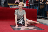 Scarlett Johansson posed for the press with her new star on the Hollywood Walk of Fame.