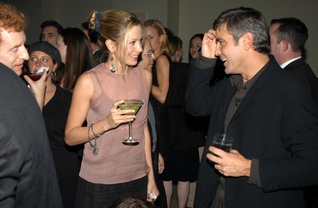George Clooney mingled with Mira Sorvino at a December 2002 party at LA's W Hotel.